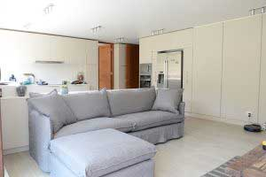 sofaonline - sofa a medida con puf independiente Ana y tela de lino gris