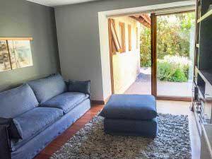 sofaonline - sofa a medida con puf independiente Ana y tela de lino azul